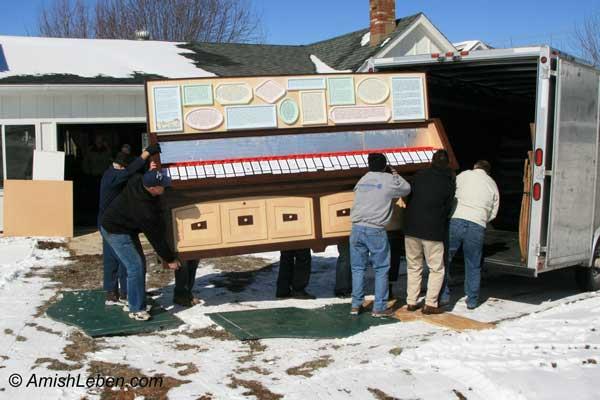 Moving Leroy's Ausbund Hymnal display to Behalt, The Amish/Mennonite Heritage Center